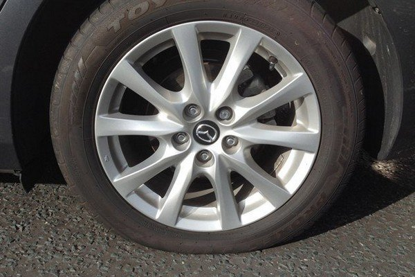A punctured car tyre