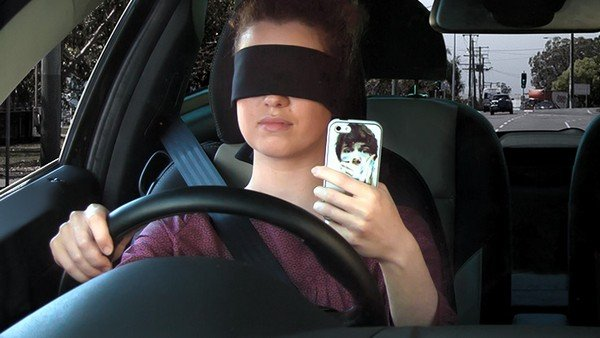 driving car with closed eyes phone using while driving