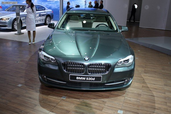Car in dark green colour front look