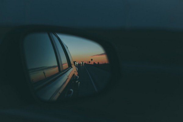 Adjust the mirror to avoid the blind spots