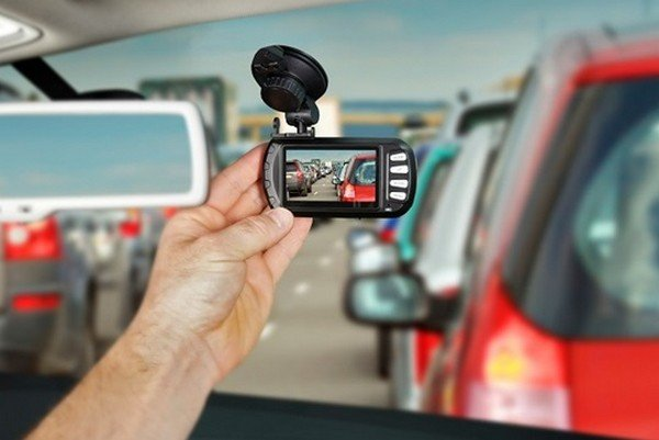 Dashcam attached to windscreen of a car