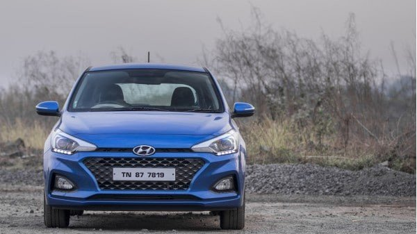 blue 2018 Hyundai Elite i20 parking on road, direct front view