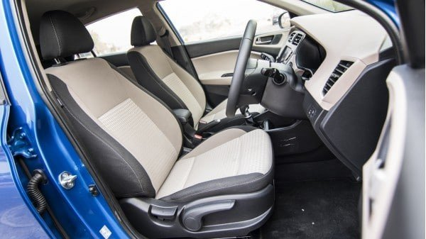 blue 2018 Hyundai Elite i20's front seat, right side front door being open