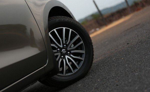grey Maruti Dzire's alloy wheel
