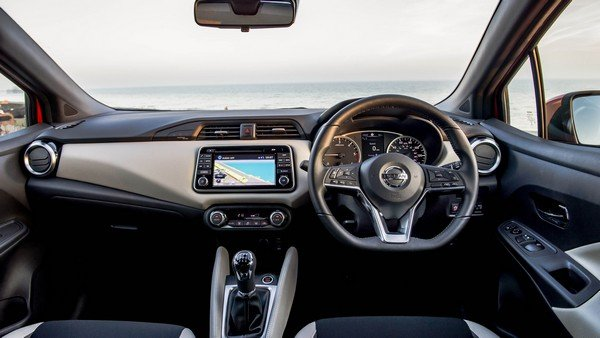 2018 Nissan Micra's behind-the-wheel view, front cabin, nature background of sky and sea