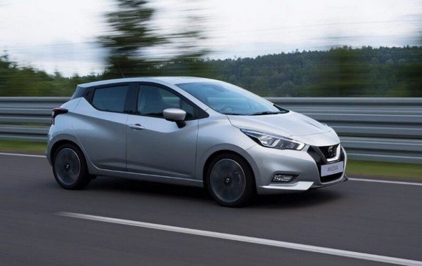Silver 2018 Nissan Micra running on road, left side view