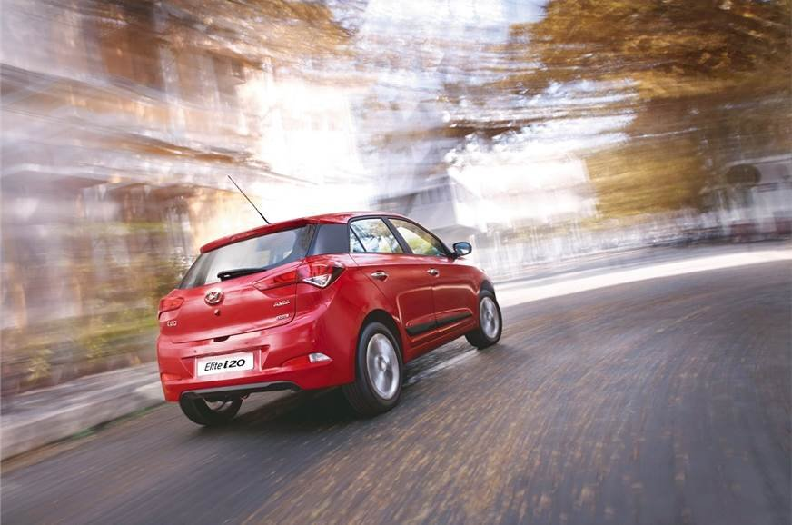 Hyundai Elite i20 red colour on the road rear look