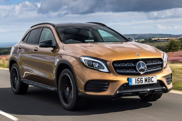 chocolate brown Mercedes-Benz GLA 2018 running on road, angular front left side view