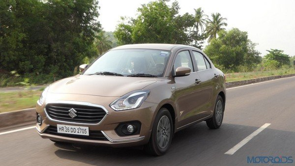 Maruti Dzire on road front angle look brown color