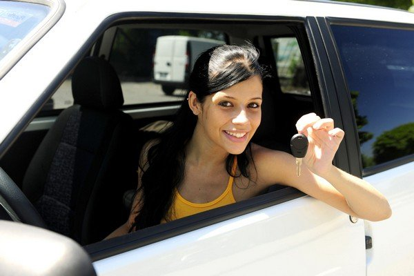indian teen girls holding a key in a car