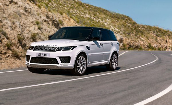 Range Rover white color angle view on road
