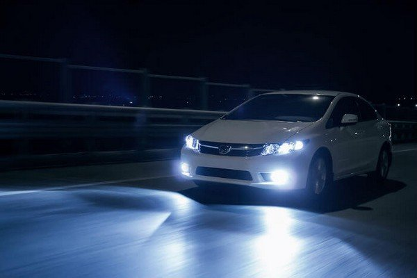 car driving at night with light on
