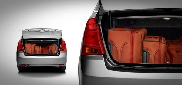 ilver Mahindra verito's boot space stuffed with luggage, boot lid being open