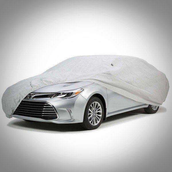 A grey car cover over a Toyota
