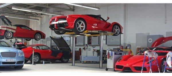 red supercar in a repairing workshop