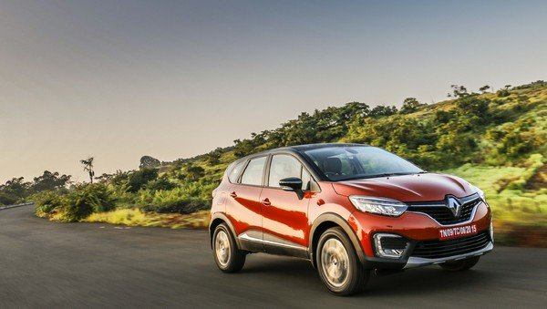 Renault Captur orange color on road
