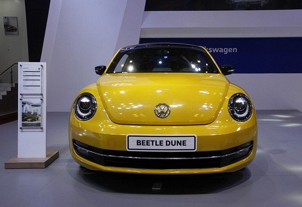 Beetle car yellow direct front look