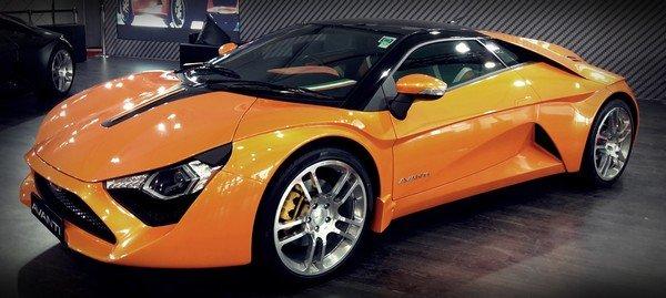 A brand new orange DC Avanti in a showroom