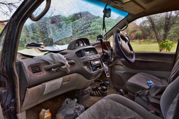 A dirty and messy interior of a car