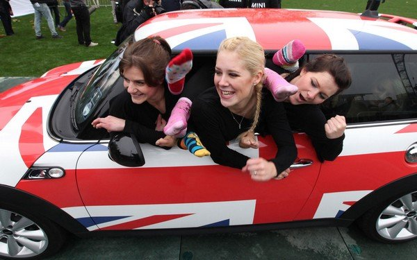 three women in a small car
