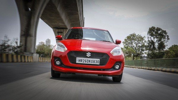 Maruti Swift red color on road