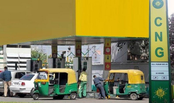 a green and yellow CNG station