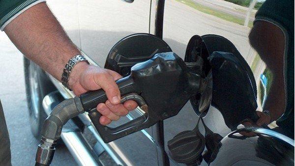 a hand pump petrol for a black car