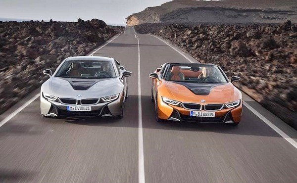 2018 BMW i8 Roadster running beside another vehilce