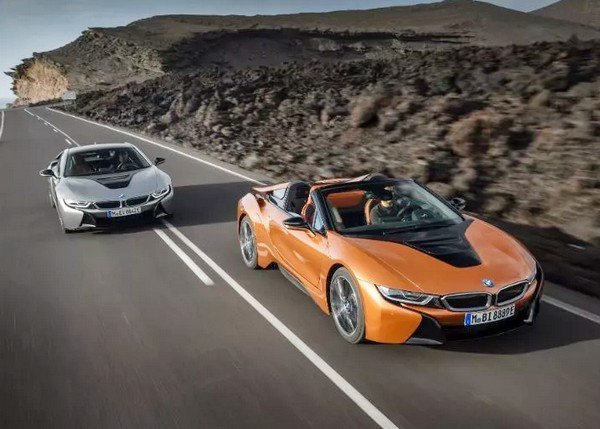 2018 BMW i8 Roadster running ahead of another vehicle