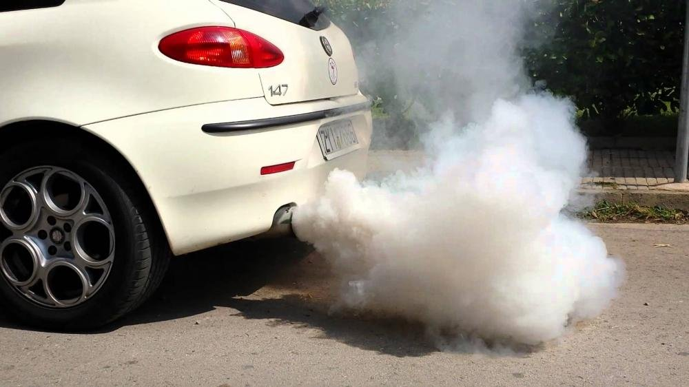 petrol white smoke