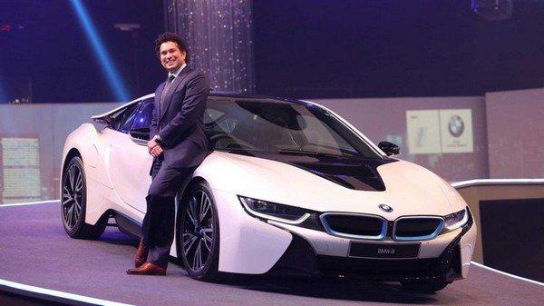 Sachin Tendulkar besides a BMW