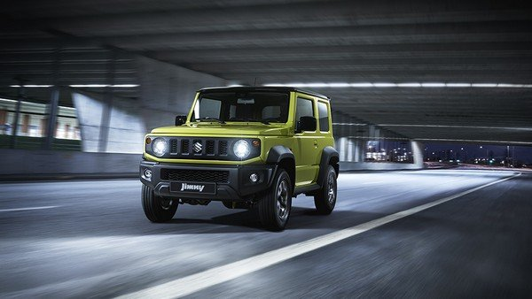 Suzuki Jimny green color front look on road