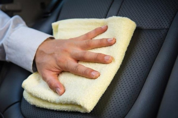 clean a car seat with a towel