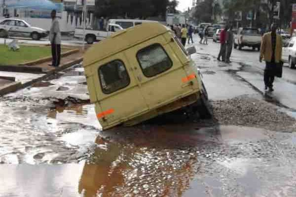 a bus is trapped in a pothole