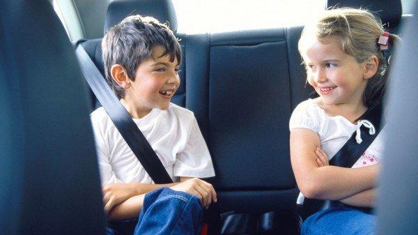 two kids wearing seatbelt
