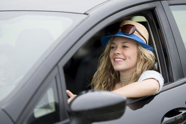 a girl next to an open car window