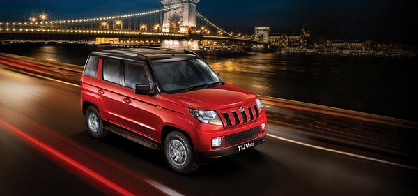 Mahindra TUV300 red color on road