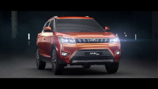 Mahindra XUV300 from left to right with headlights on