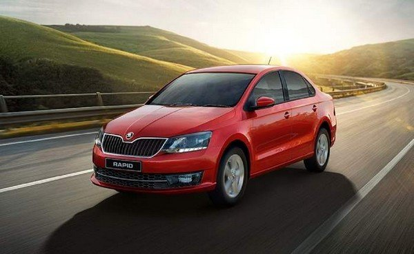 Skoda Rapid red color on road front and side look