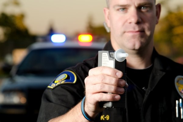 police holding a breathalyser