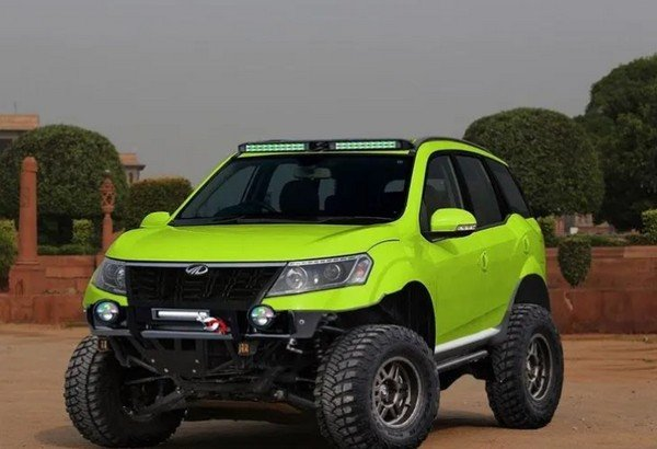 off-road mahindra xuv50 rendered bright green front angle