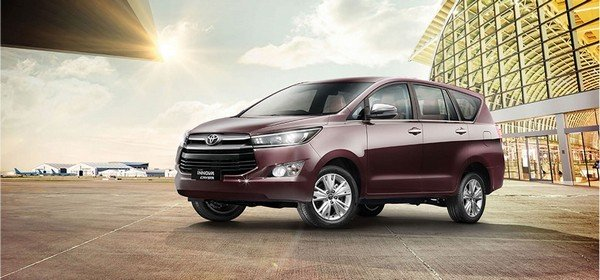 toyota innova crysta brown front side angle