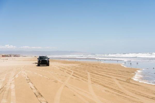 A car next to the shoreline
