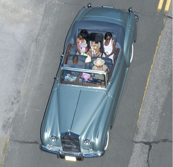 Jay-Z and Beyonce in Rolls-Royce Silver Cloud Convertible