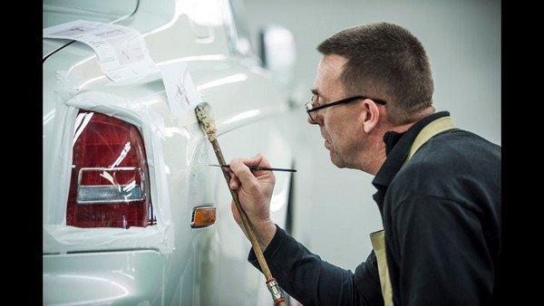 man painting a rolls royce
