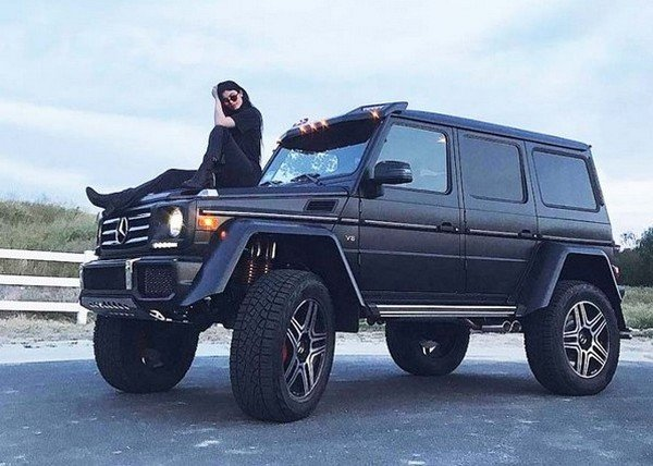 kylie sitting on her g wagon