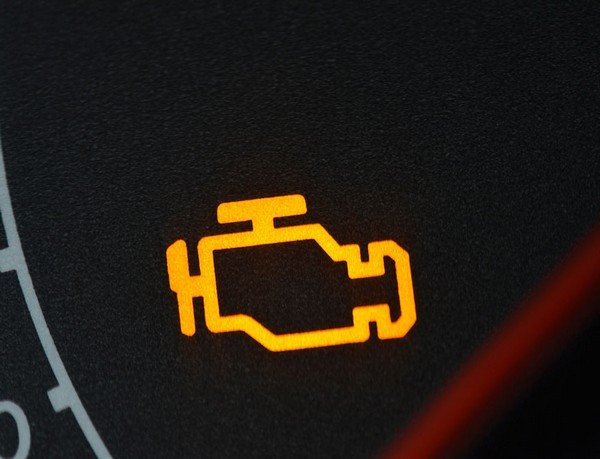 Yellow engine warning light on dashboard