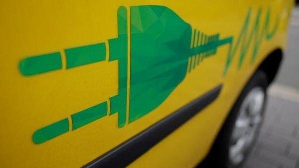 side shot of the car with EV plug logo