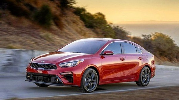 2020 Kia Rio red color running on the road