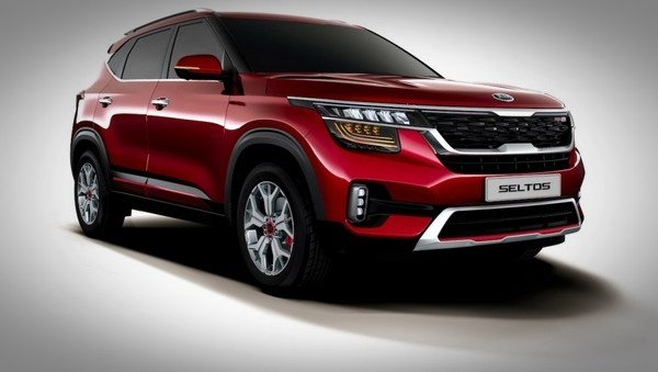 kia seltos red front three quarters right side